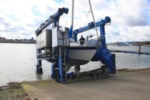 MYC travel hoist hauling a members boat